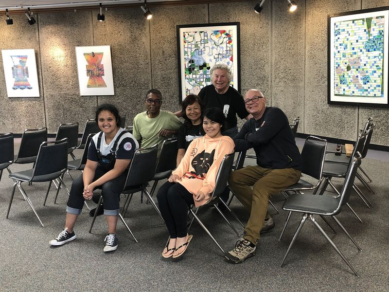 A group of art students gathered in CC 301