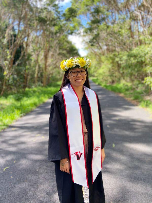 Keely Kitamura wearing graduation attire
