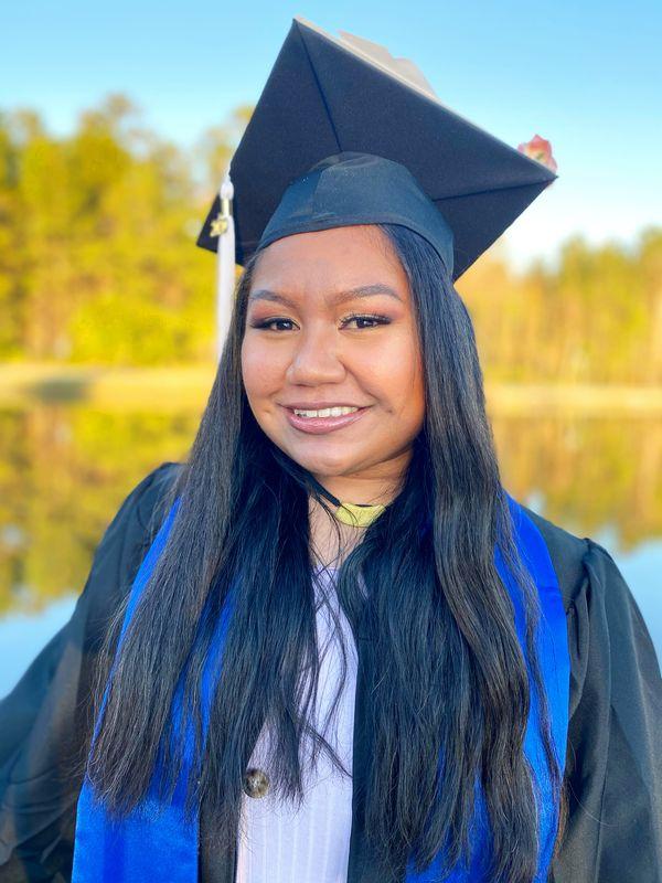 Kiara Ngeribongel Ringang smiles in graduation attire