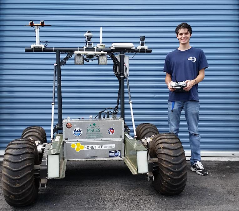 UH Hilo computer science student is practicing controlling the PISCES rover.