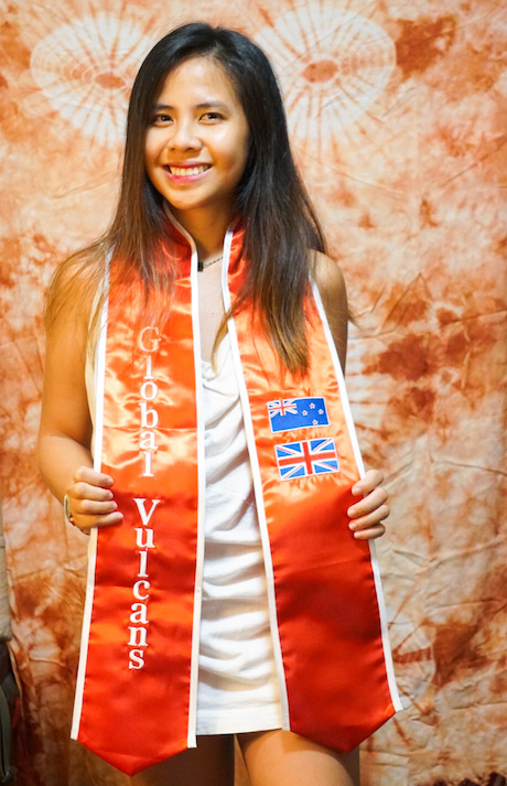 UH Hilo graduating student with Global Vulcans sash