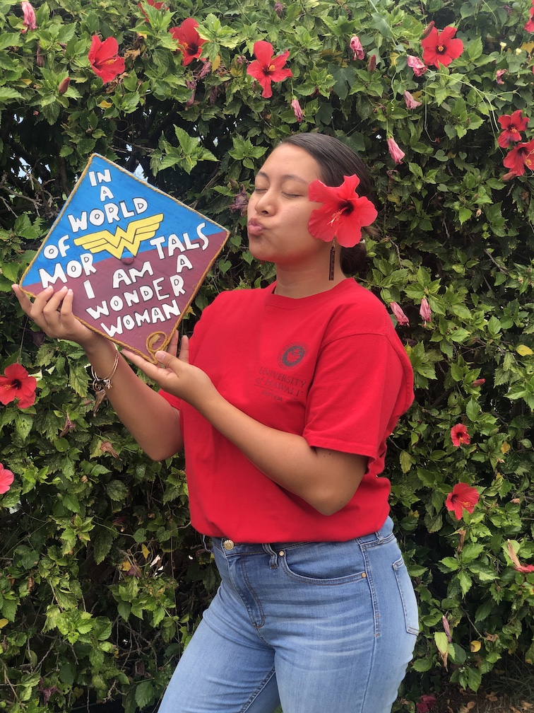 UH Hilo graduating student with Wonder Woman cap