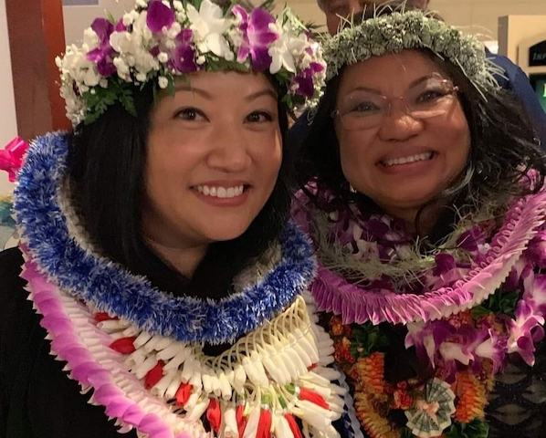 Two students adorned in Lei