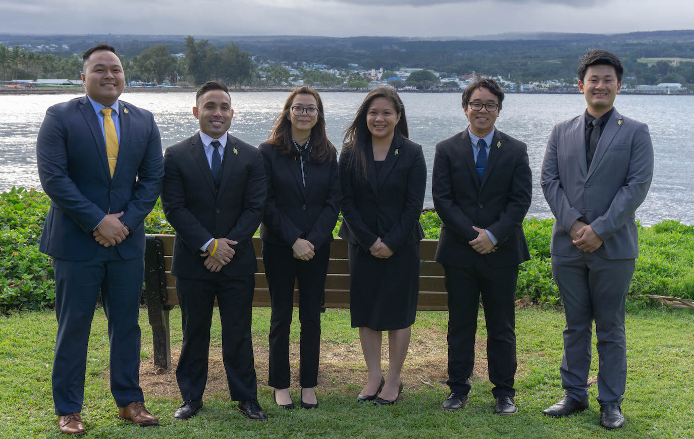 Some very well dressed, newly minted pharmacists at Hilo bay.