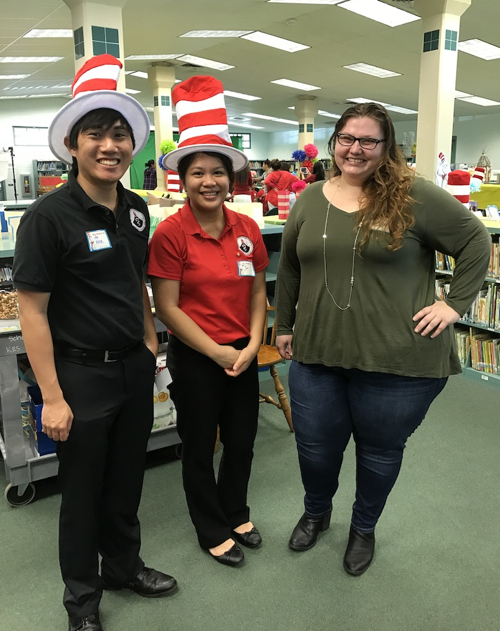Pharmacy students wearing comical hats at an educational event