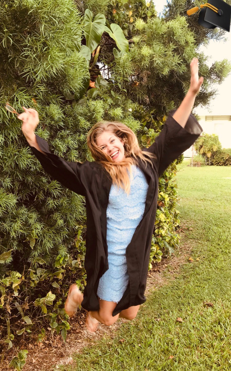 Student jumping for joy in graduation gown