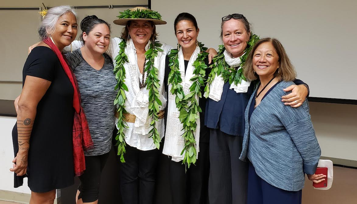 UH Hilo Students and faculty celebrate with leis.