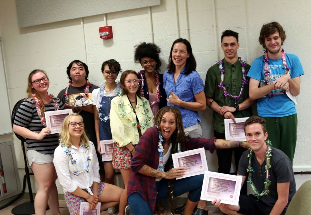 UH Hilo physics department smiles together for their award ceremony.