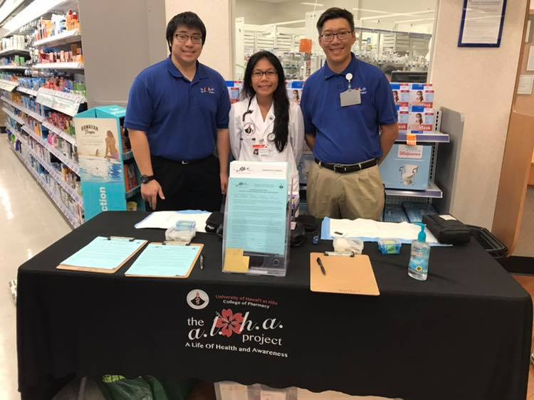 "UH Hilo pharmacy students presenting the ""A.L.O.H.A"" project in a local pharmacy."