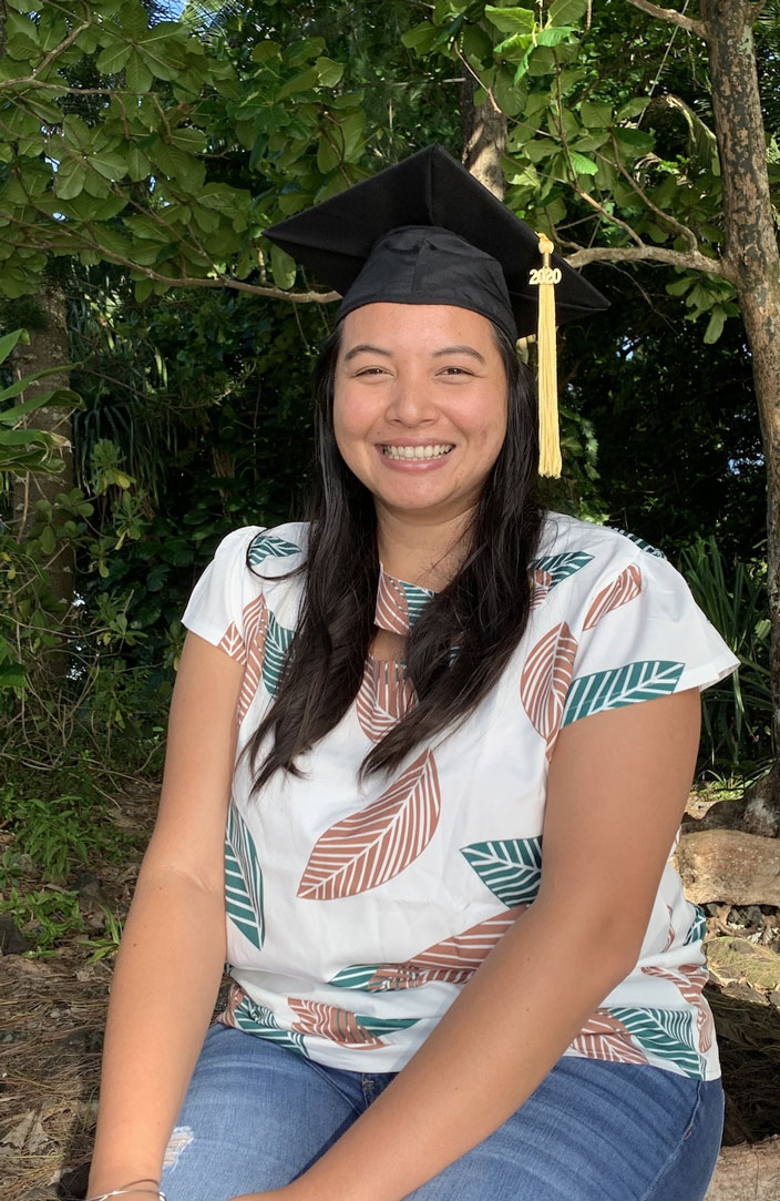 UH Hilo graduating student smiling in the shade