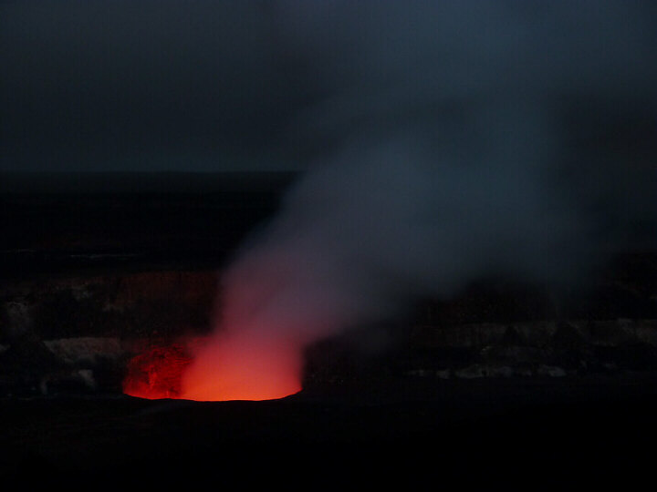 Halemaumau crater glows against the darkness