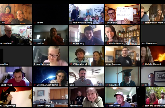 A screen shot from a computer shows the faces of participants in a remote meeting
