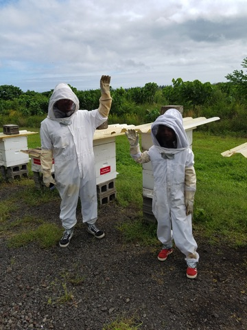 two Jonathan and Clea Zimmerman in beekeeping suits