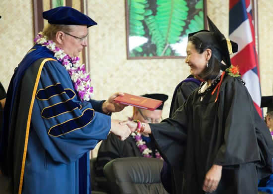 Chancellor Straney awards a degree during the 2013 spring commencement ceremony