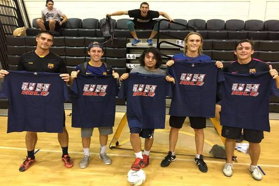 Winners of the Intramural Soccer Championship holding up their prizes, which are UH Hilo t-shirts