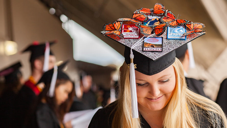 An intricately decorated mortarboard shows this spring graduate's passion