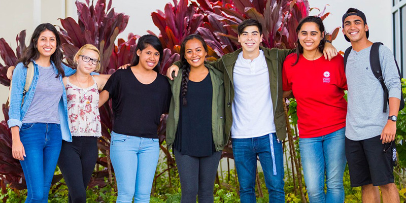 Students welcome people to UH Hilo
