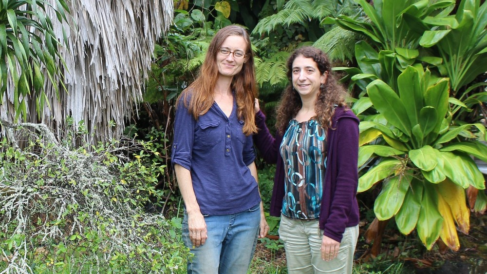 Joaana and Becky standing in garden on campus.