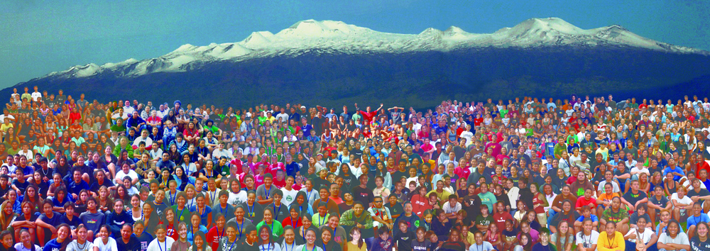 Large group of students with Maunakea in background.