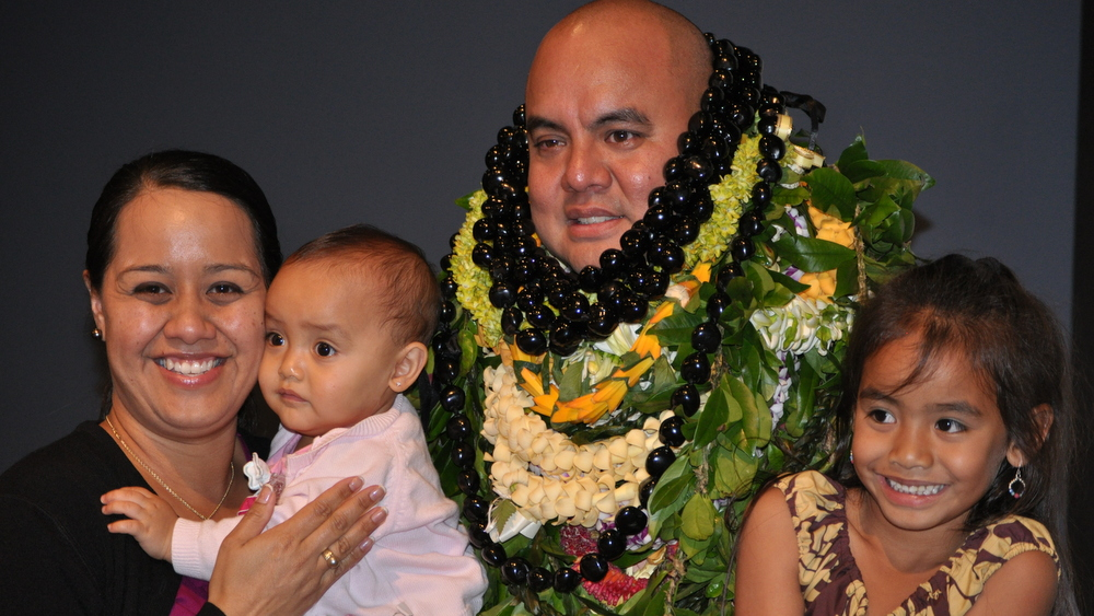 Hiapo with wife and two children.