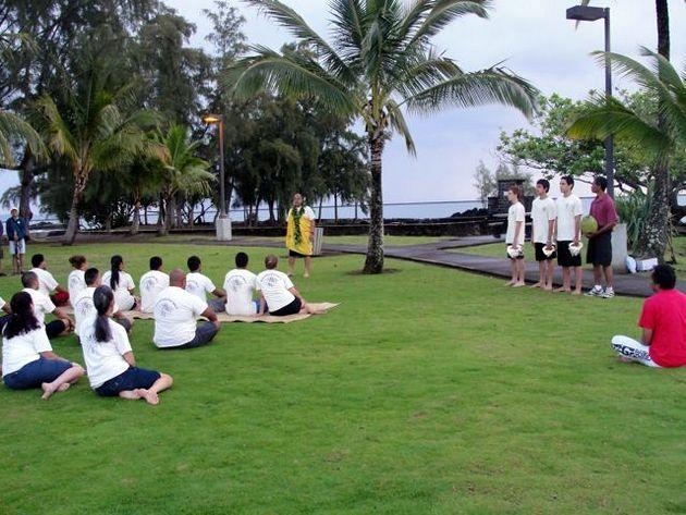 conducting traditional ceremony for soon to be graduates of Ke Kula ʻO Nāwahīokalaniʻōpuʻu Hawaiian Language Laboratory School