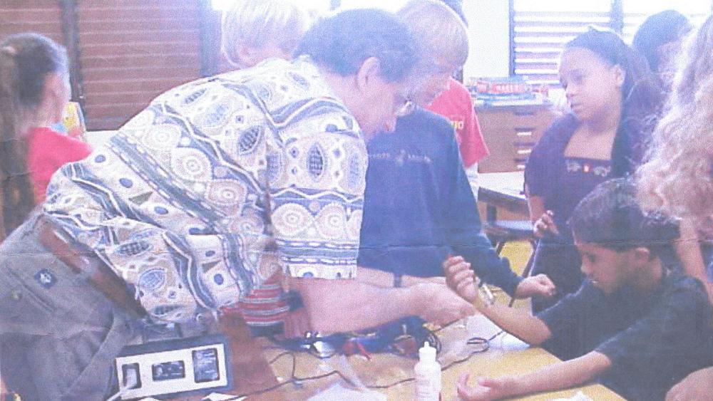 Dan Brown showing school children medical equipment.