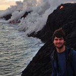 Michael Sthreshley, background is lava flowing into ocean with steam rising.