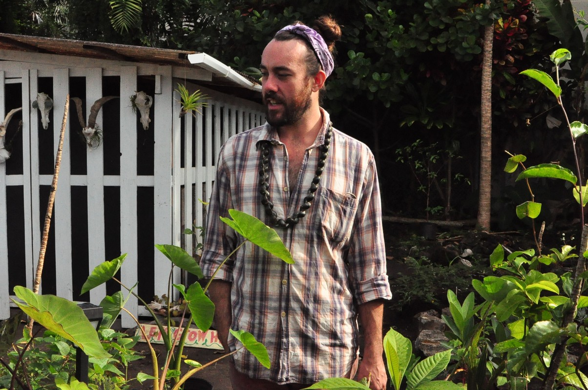 Mikey Pierron stands in garden.
