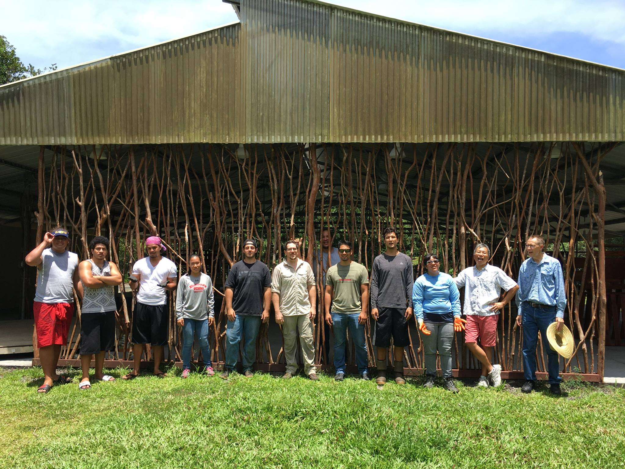 Students stand for photo in front of the UH Hilo farm pavilion.