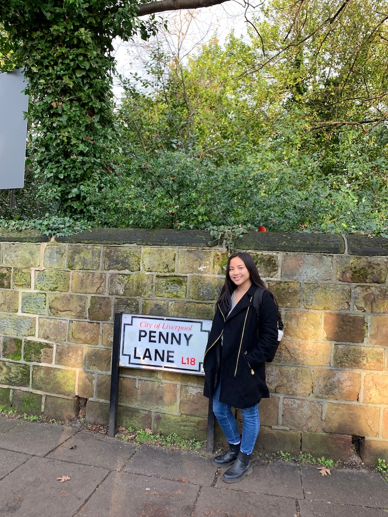 Jessica Standing Near Penny Lane Sign