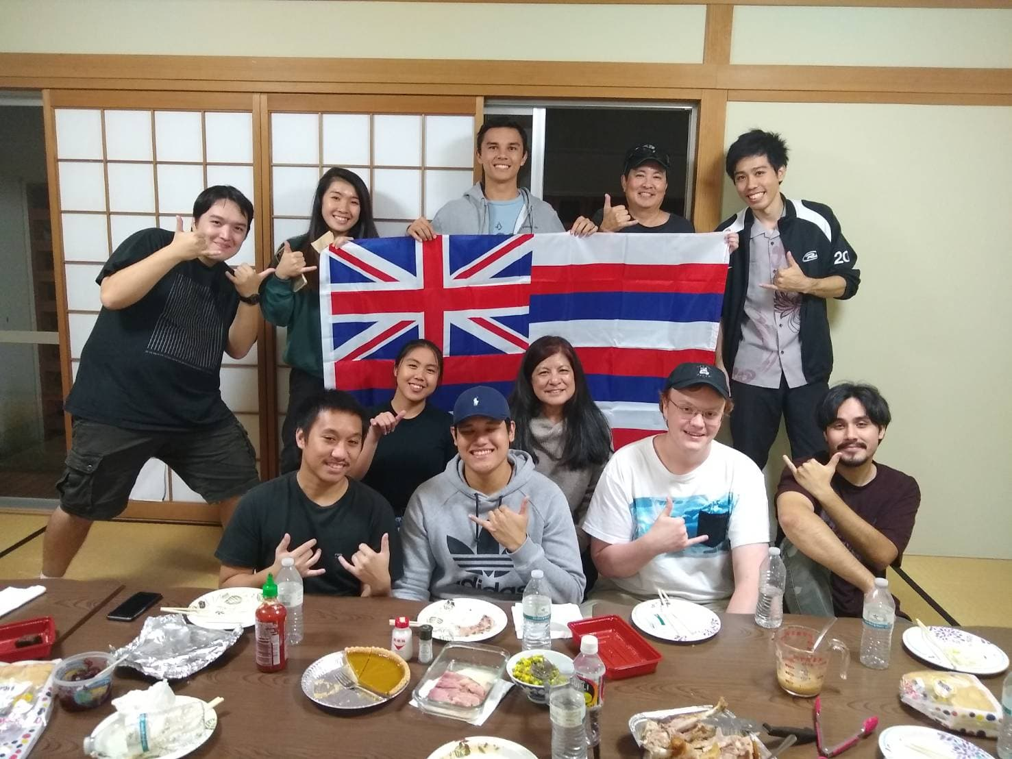 Hawaiian students holding flag