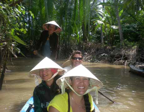 Crystal Shanyfelt and crew on a small boat in the jungle