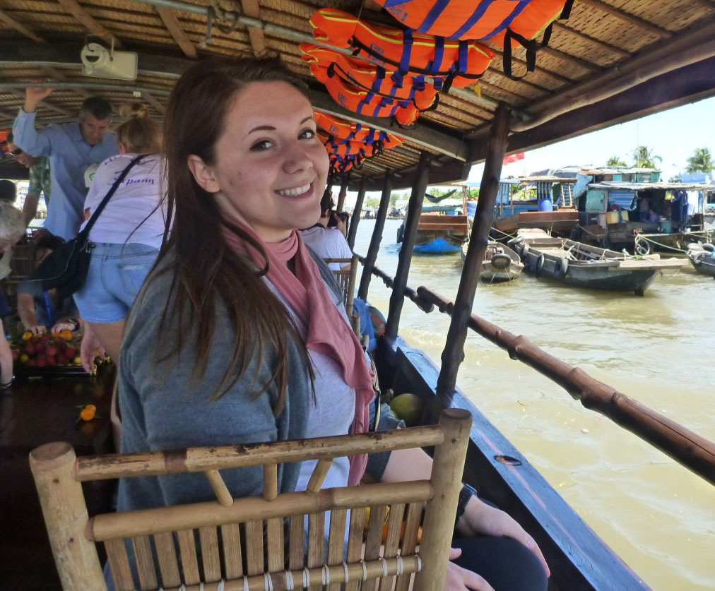 Amy floating along the Mekong Delta through the Floating Market and Village in Can Tho
