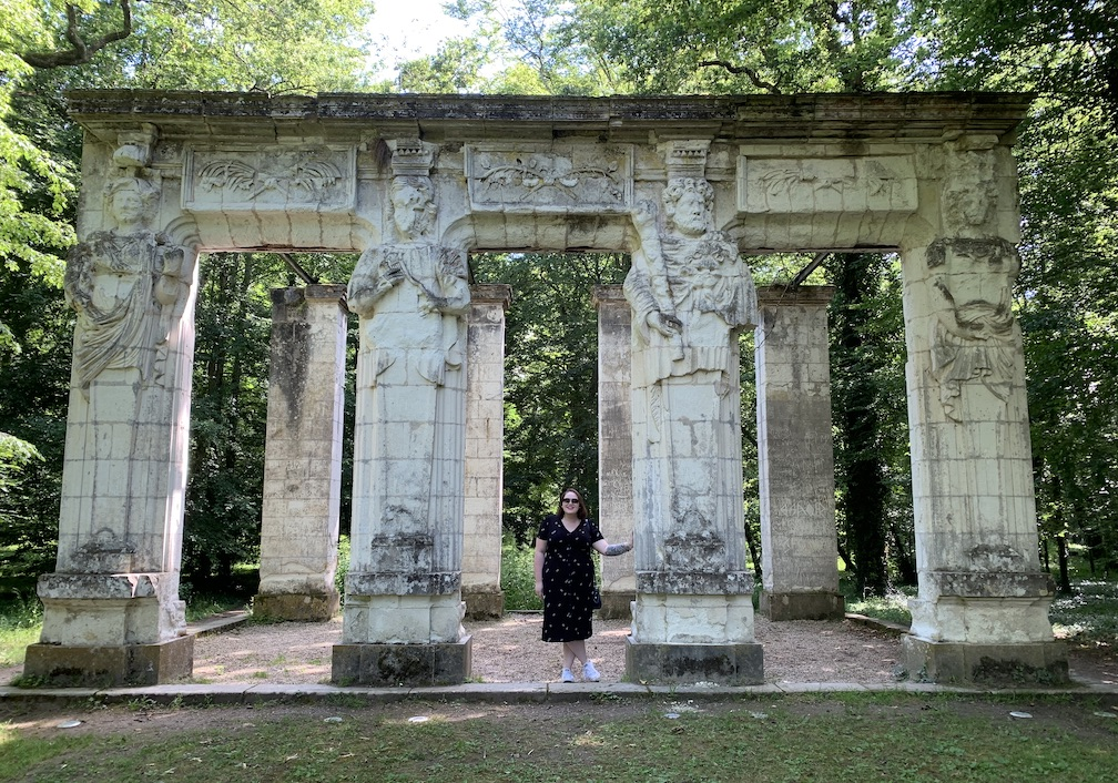 Woman standing between columns