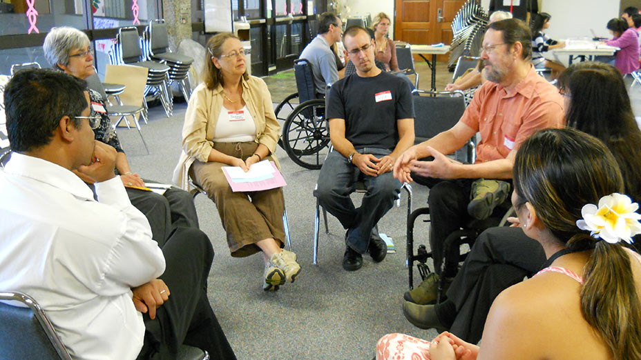 Dr. Shawon Rahman and guests listening to a lecture by Dr. Ron Amundson at the  2010 Disability Awareness Forum.