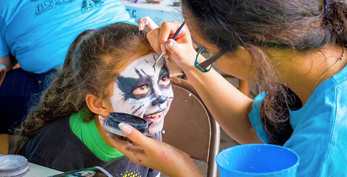 Face painting is one of the many activities at the Earth Day Fair.