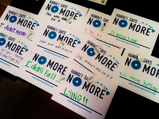 "Students created ""No More"" posters with personalized messages denouncing domestic violence."