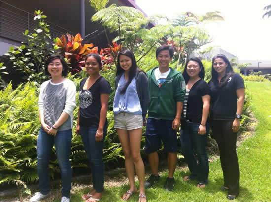 Members of the Student Health Advisory Council pose outside of the Student Services Center.