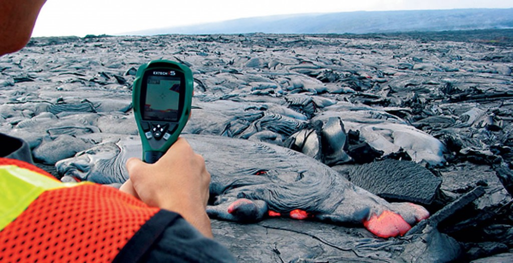 A student measures the temperature of lava with a radiometer.