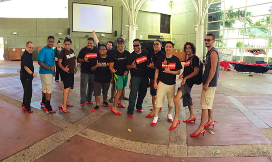 "Men walked in red high heels to ""walk a mile in her shoes"" to raise domestic violence awareness."