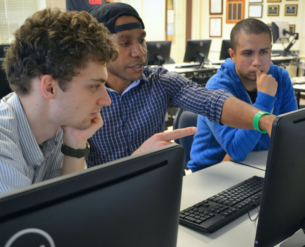 Computer Science student Joshua Parep assisting fellow students
