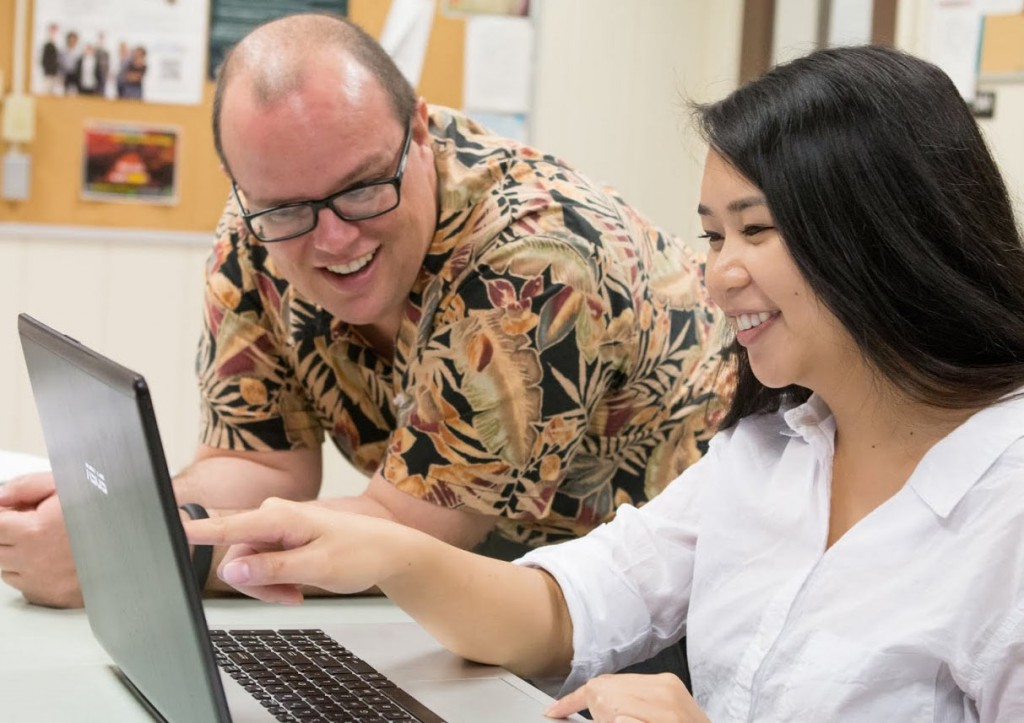 Dr. Keith Edwards works with a student at her computer