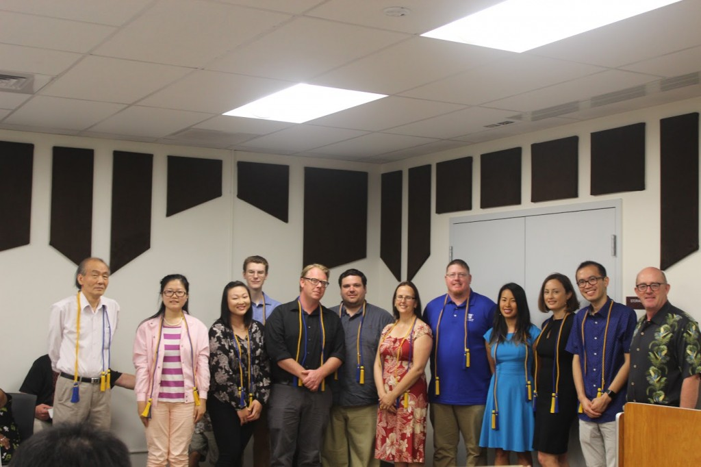 Newly inducted Beta Gamma Sigma members along with Dr. Terrance Jalbert, CoBE Professor of Finance and Dr. Eric Im, CoBE Professor of Economics
