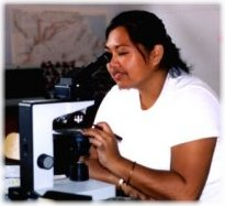 photo of student with microscope